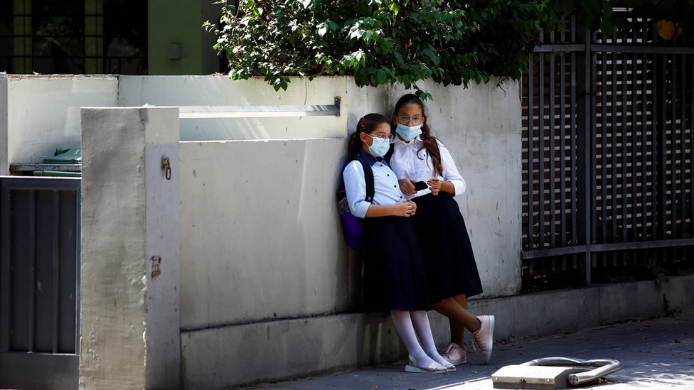 Girls wearing protective face masks look on in Tel Aviv, Israel September 15, 2020