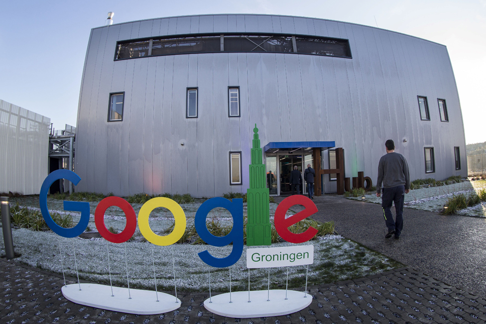 A picture taken on December 6, 2016 shows Google Groningen logo for the office during the opening of the new Google data centre in Eemshaven, near Groningen.
