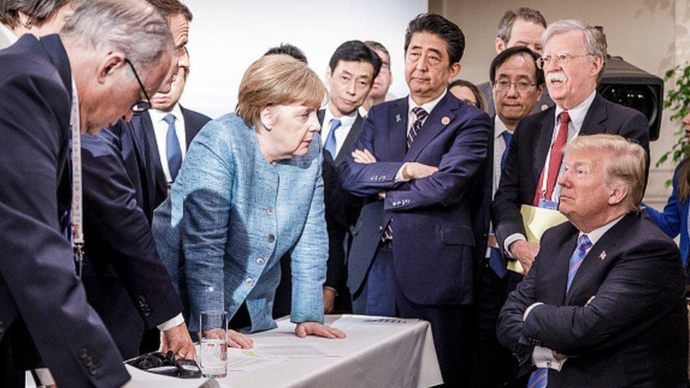 German Chancellor Angela Merkel deliberates with US president Donald Trump