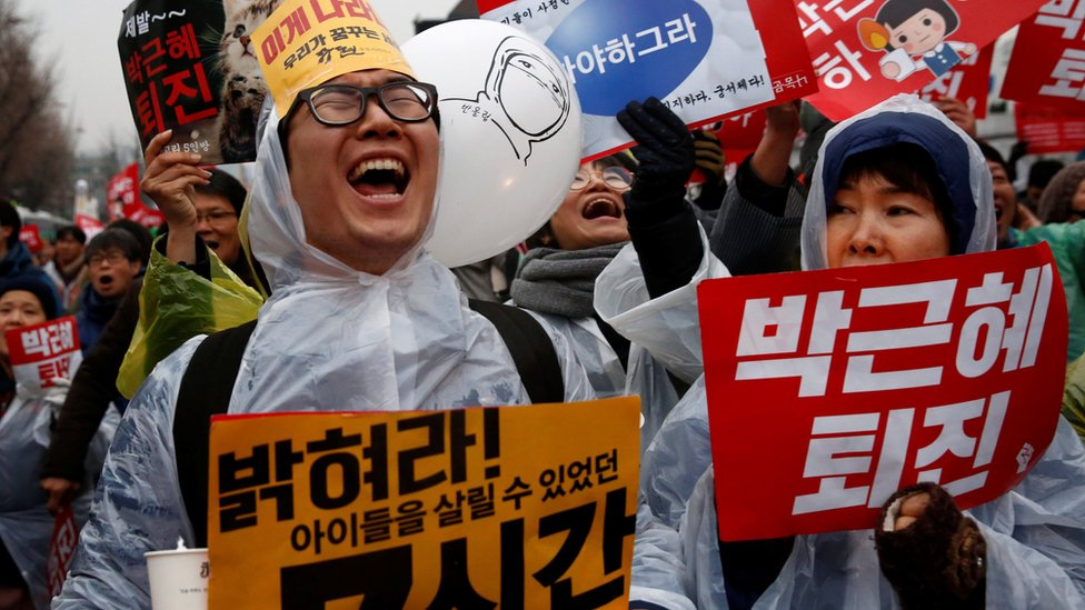 Protesters shout slogans at a protest calling South Korean President Park Geun-hye to step down in Seoul, South Korea
