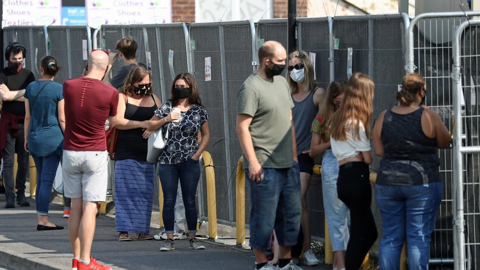 People queue outside a walk-in Coronavirus testing centre in Marlborough Road in Southampton.