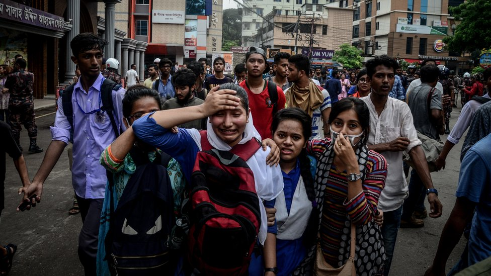 A woman cries after clashes with police during a student protest in Dhaka on August 5, 2018