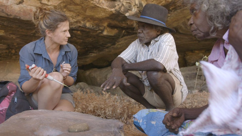 Scientists Dr Elspeth Hayes (left) with Mark Djandjomerr (centre) and May Nango (right) at the dig site