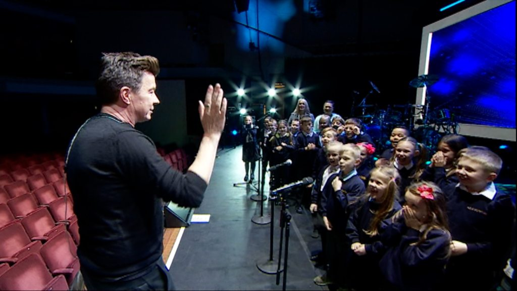 Rick Astley sings with Nottingham schoolchildren