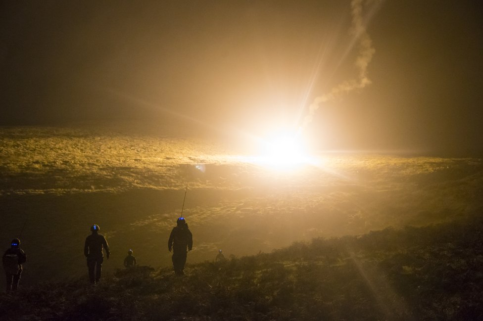 Members of 15 Squadron RAF Regiment move across the hills during a training exercise at Dartmoor Training Area