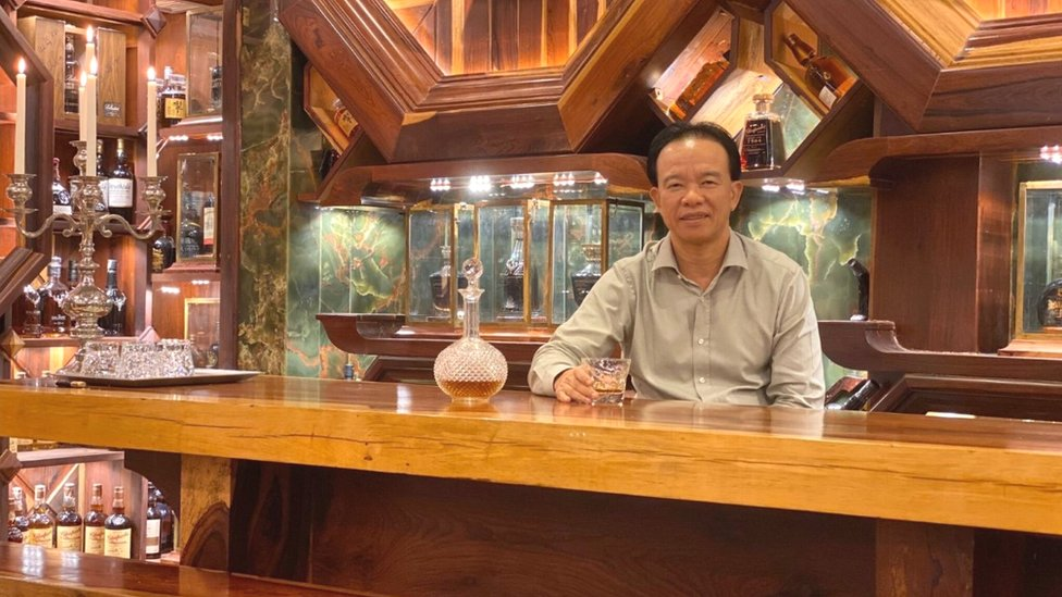 Mr Viet Nguyen Dinh Tuan with his whisky collection