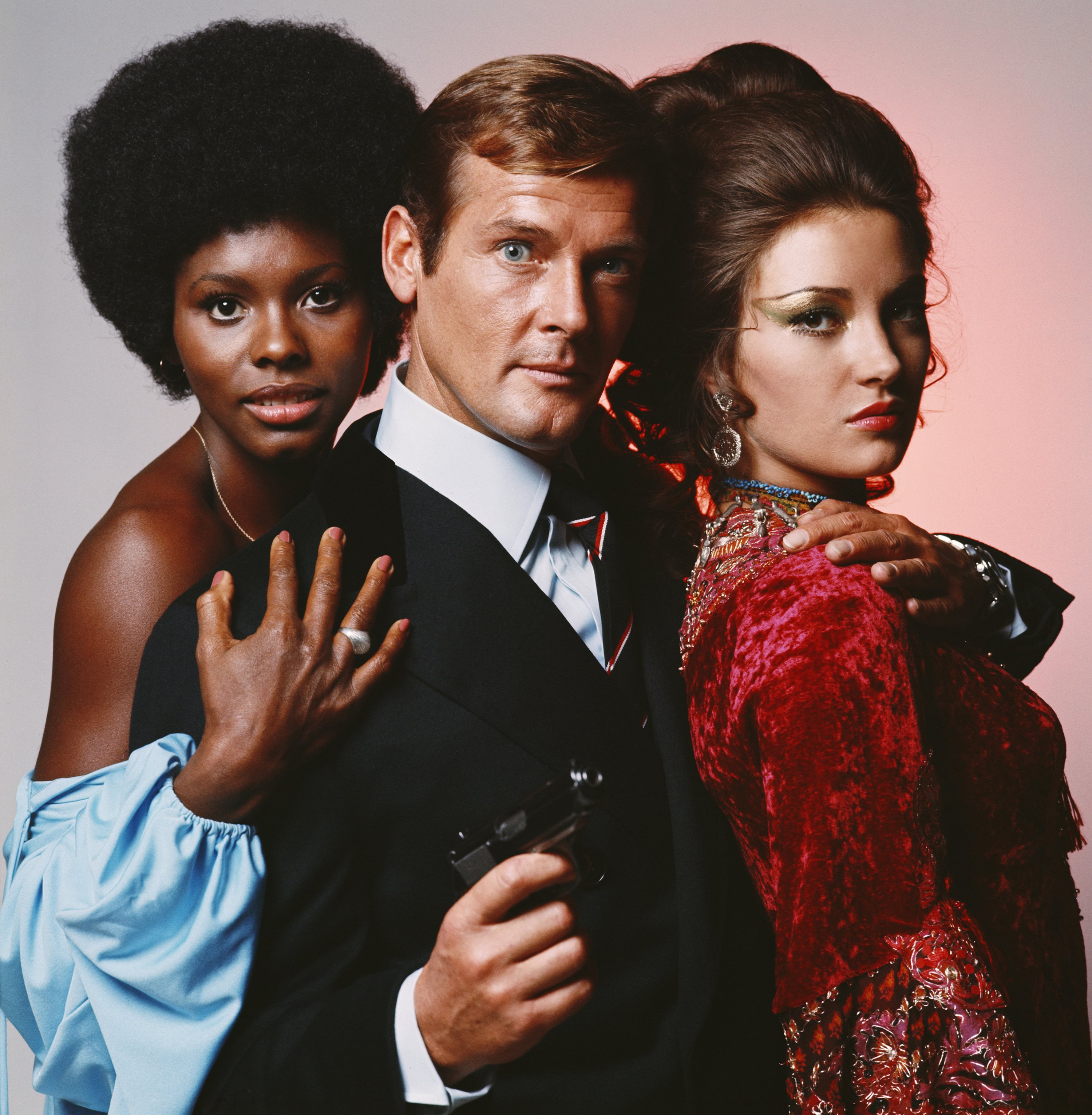 Actor Roger Moore as James Bond with Live and Let Die co-stars Gloria Hendry (left) and Jane Seymour in 1973