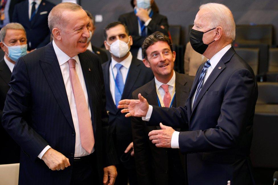 US President Joe Biden (R) speaks with Turkey's President Recep Tayyip Erdogan (L) during a plenary session at a NATO summit in Brussels, Belgium, 14 June 2021