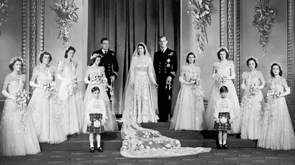 The Queen and Prince Philip with the bridal party at Buckingham Palace on their wedding day.