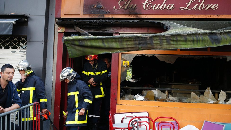 Firefighters leave after inspecting the damaged Au Cuba Libre bar in Rouen, northern France (6 August 2016)