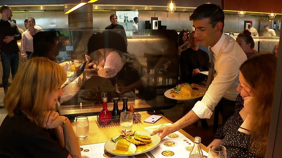 Rishi Sunak serving meals to customers