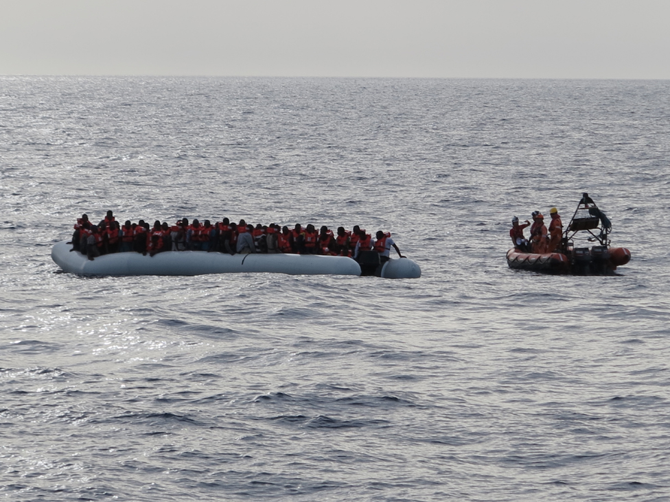 Rescue boat approaches a migrant dinghy