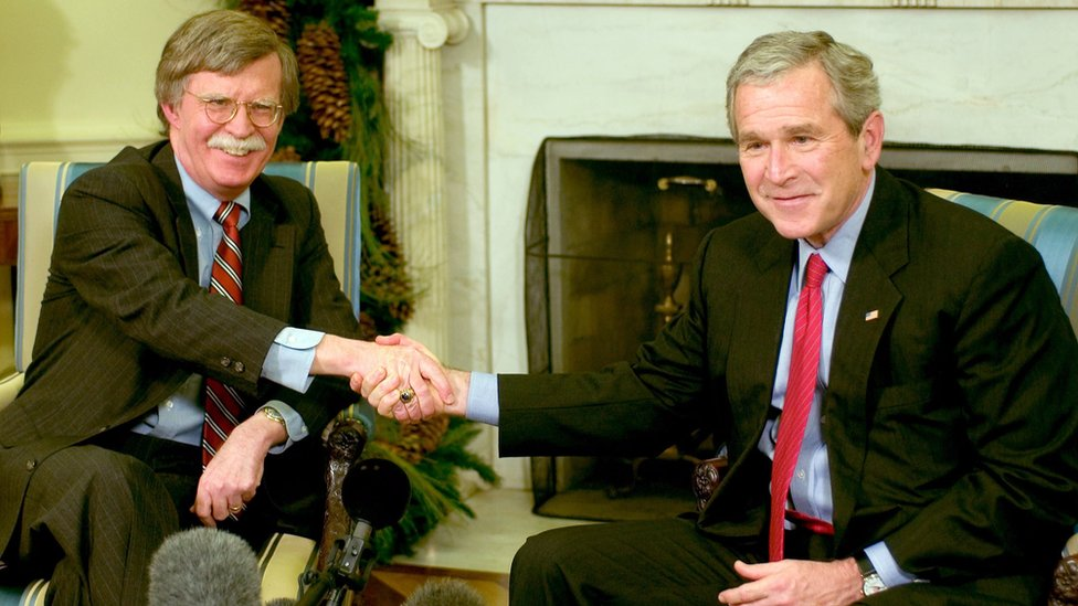 US President George W Bush (R) and Ambassador to the UN John Bolton (L) meet in the Oval Office in December 2006