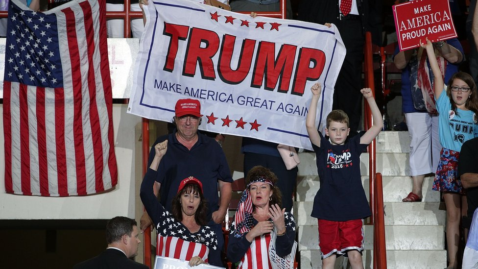 Supporters shout slogans and hold banners at a rally in Harrisburg, Pennsylvania (29 April)