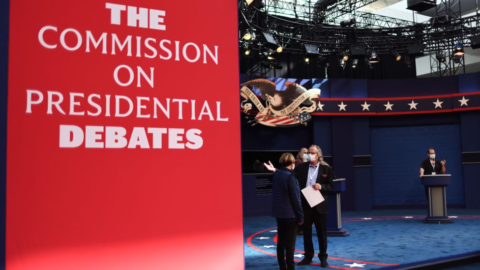 Workers prepare the stage for the first presidential debate at Case Western Reserve University