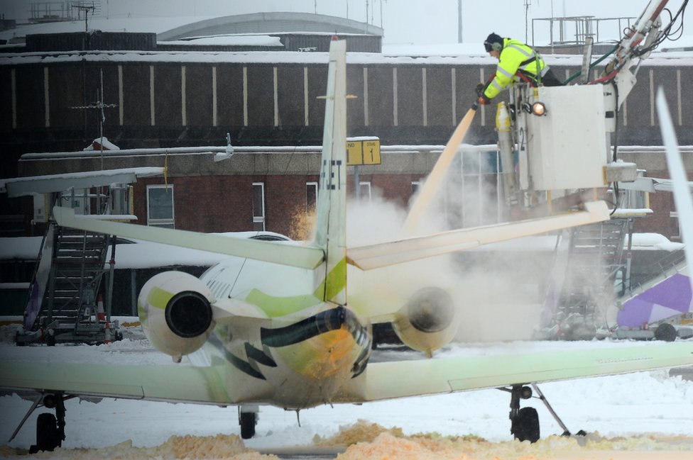 A plane being de-iced at Luton Airport in December 2017