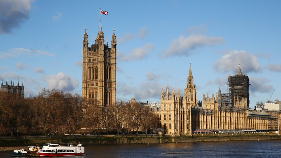 The Union Jack flying over Victoria Tower at the Houses of Parliament in London.