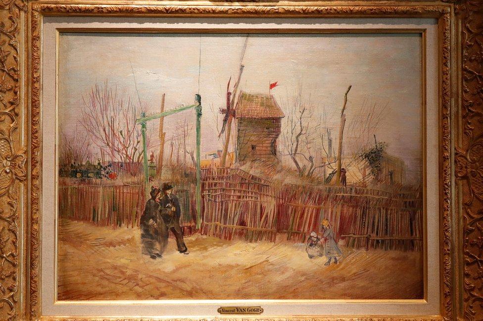 A street scene in Montmartre by Vincent Van Gogh