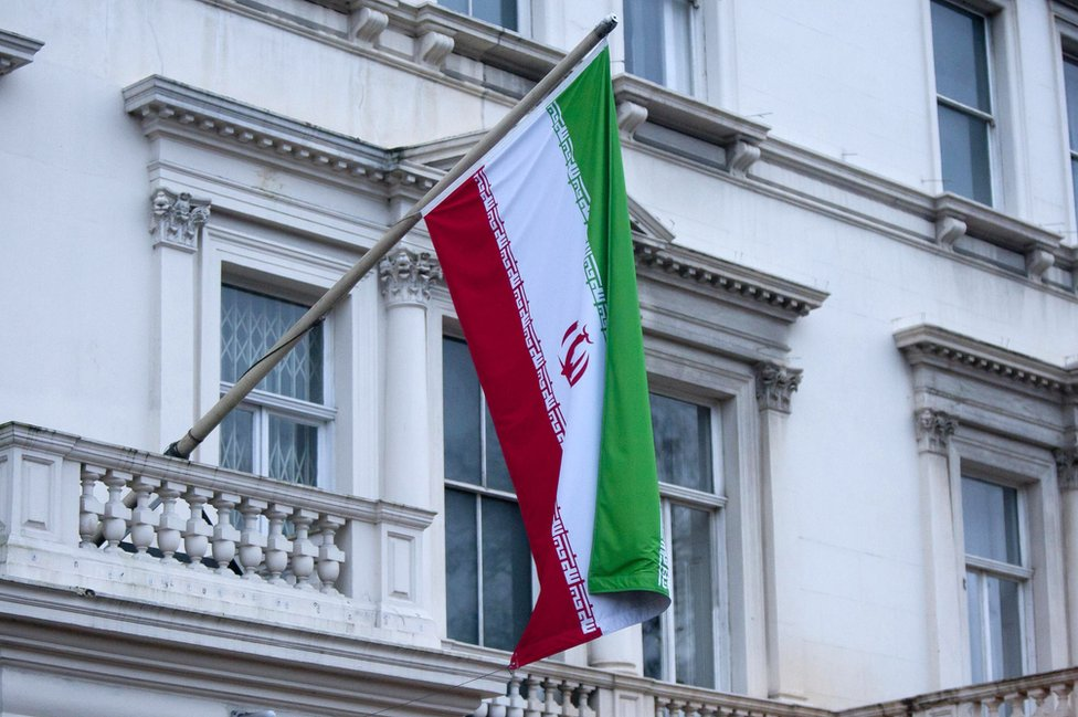A picture of Iran's flag hanging from the Iranian Embassy in central London
