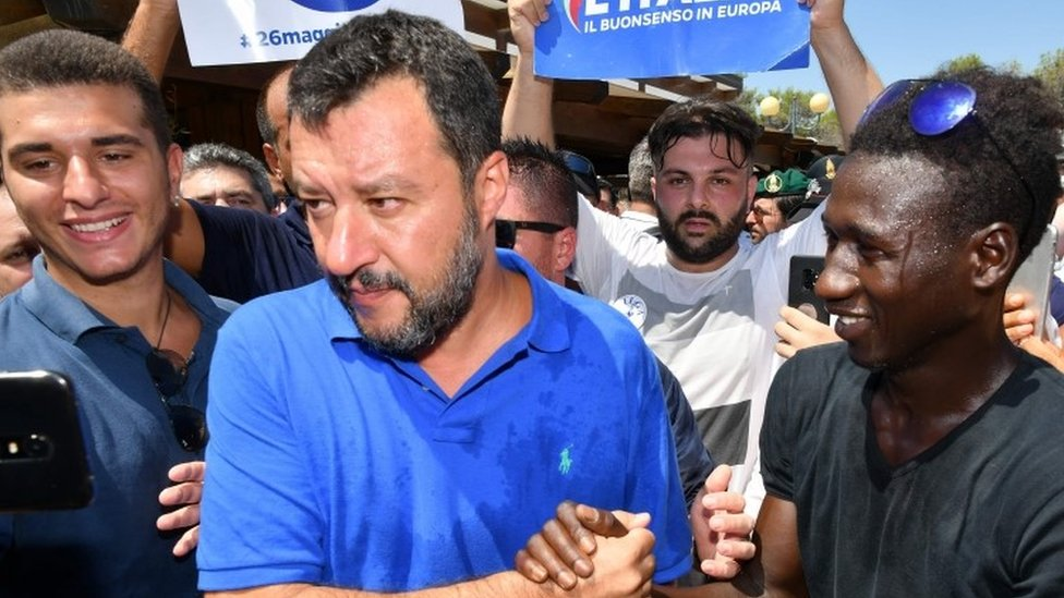 """Matteo Salvini shakes hands with a supporter during his electoral tour """"Italian Summer Tour"""" in Policoro on August 10"""