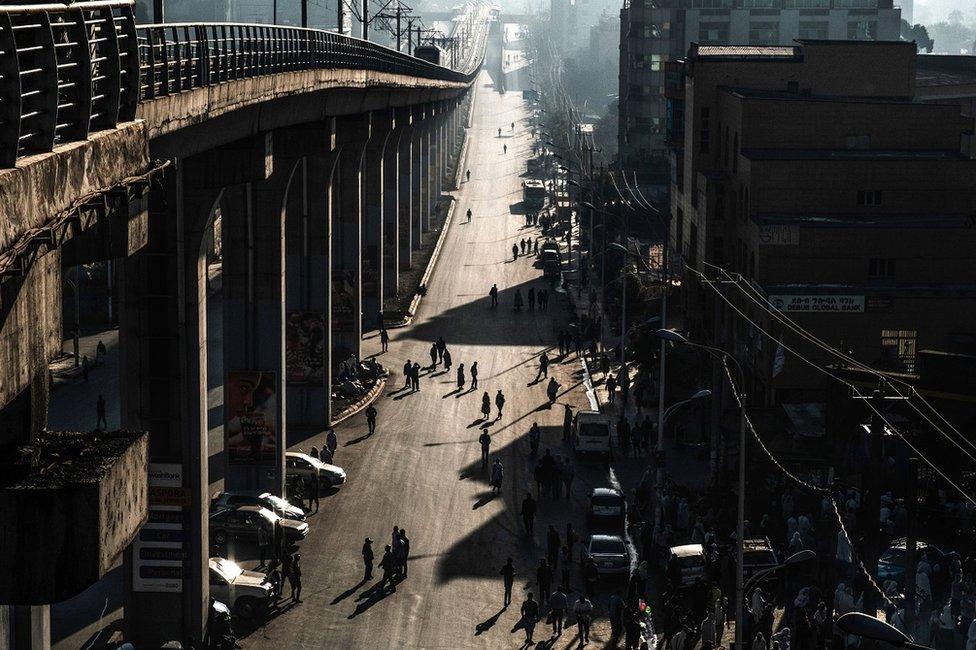 People walk along a street
