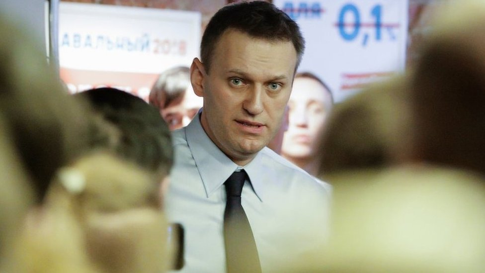 Russian opposition leader Alexei Navalny speaks with his supporters at the opening of his campaign office in St. Petersburg, Russia