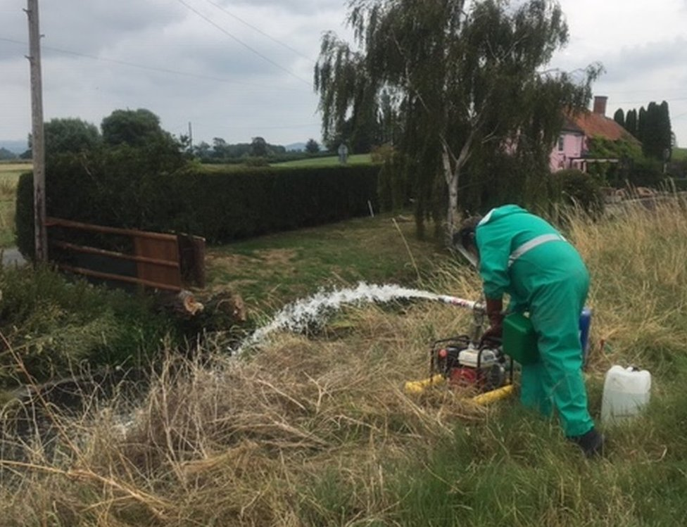 Environment Agency staff working to deal with the pollution