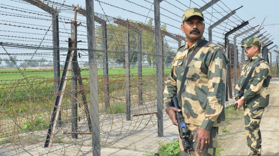 Indian Border Security Force personnel walk along a fence at the India Pakistan border on the outskirts of Amritsar on February 27, 2019.