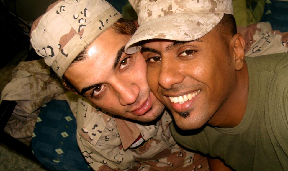Btoo Allami (left) and Nayyef Hrebid hug