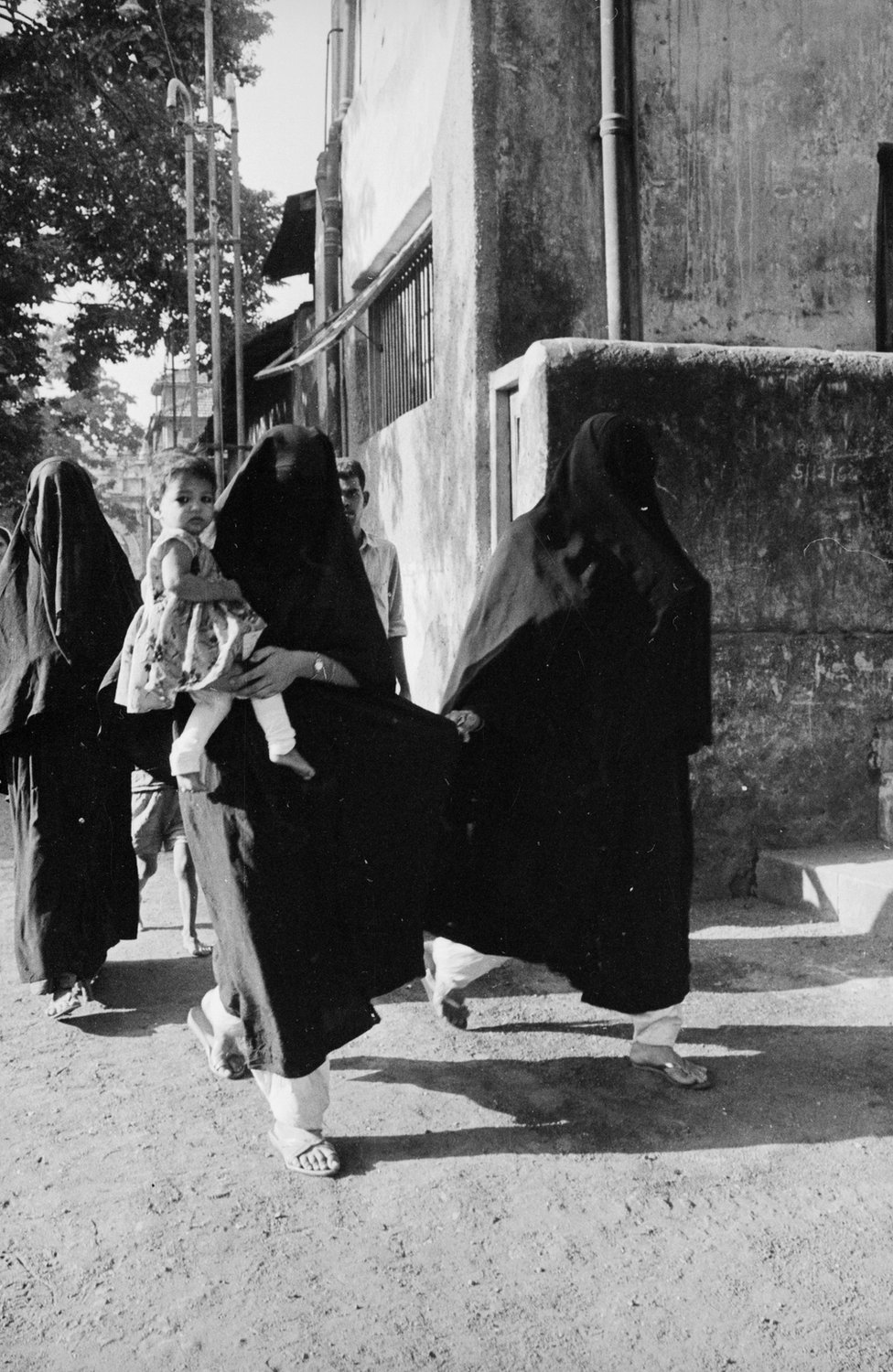 Women in burkas are on their way to vote during the Indian elections in 1967.