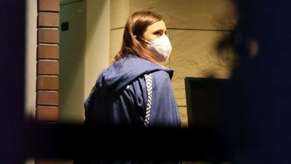 Krystina Timanovskaya walks with her luggage inside the Polish embassy in Tokyo