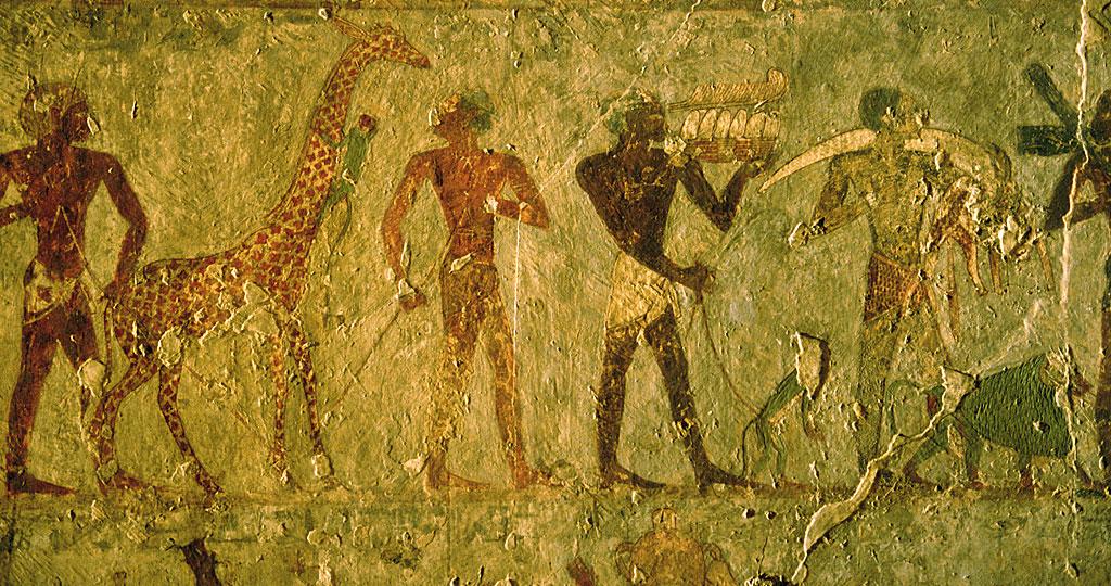 jirafas, monos, marfil y otros importes de la Tierra de Punt al desembarcar en Egipto.