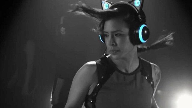 """A women wears """"Cat Ear"""" headphone speakers"""