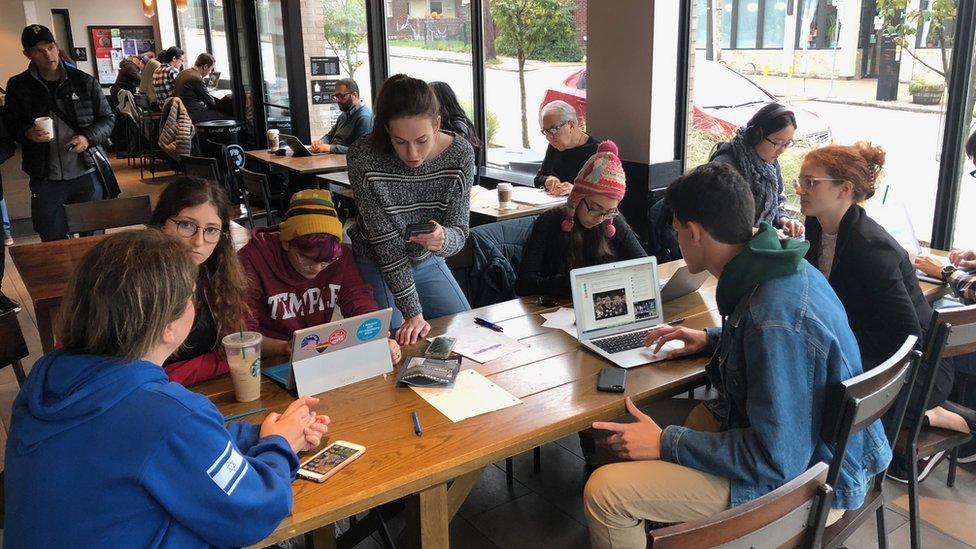 The children gather around a table in Starbucks