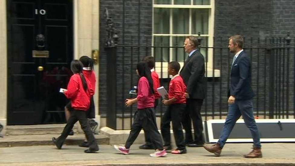 Five children from the school deliver letters to Number 10 Downing Street
