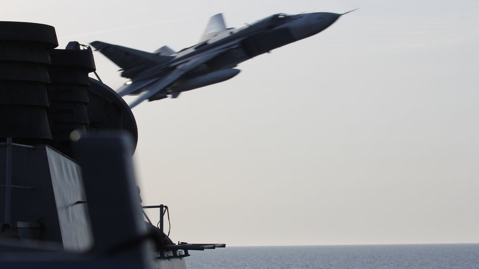 Russian Sukhoi Su-24 aircraft makes low pass by USS Donald Cook