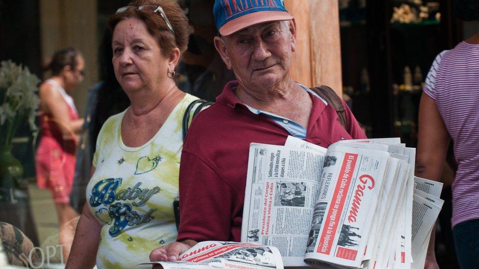 Newspaper vendor in Cuba