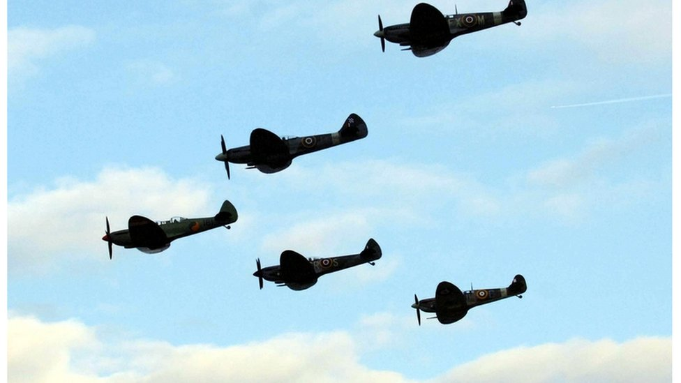 Spitfire in near-miss with light aircraft after stunt