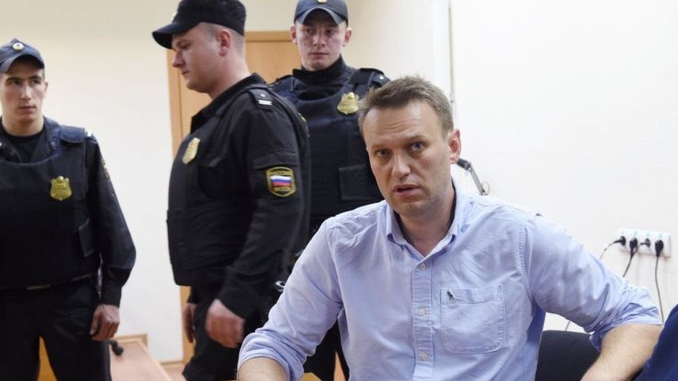 Alexei Navalny (right) speaks after a hearing in a court in Moscow. Photo: 12 June 2017