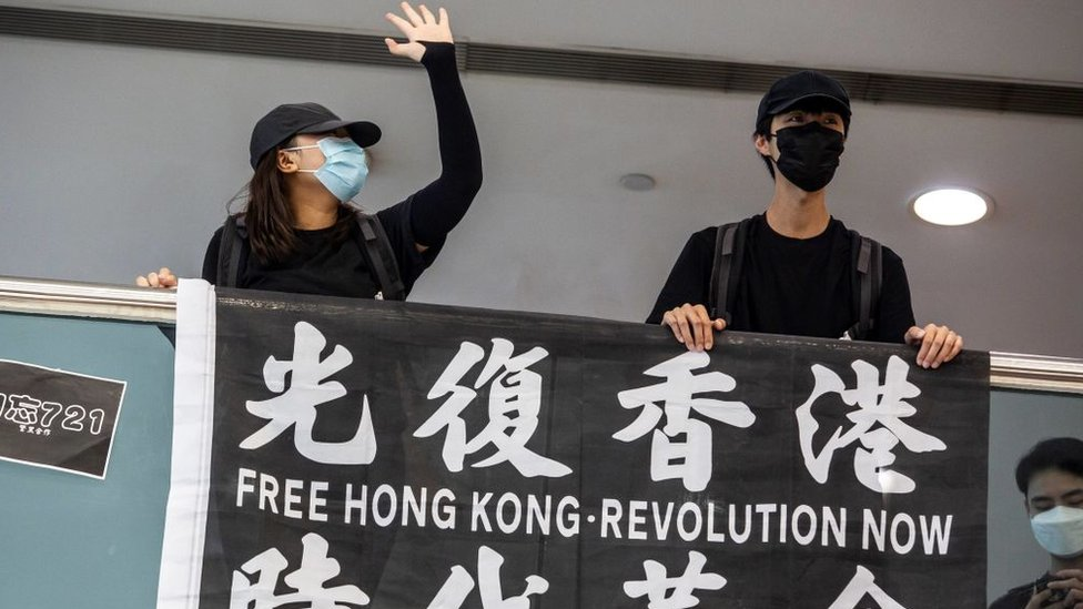 Pro-democracy demonstrators with a banner 'Free Hong Kong'