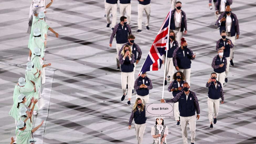 Flag bearers Hannah Mills and Mohamed Sbihi of Team Great Britain lead their team out during the Opening Ceremony of the Tokyo 2020 Olympic Games at Olympic Stadium on July 23, 2021 in Tokyo, Japan.