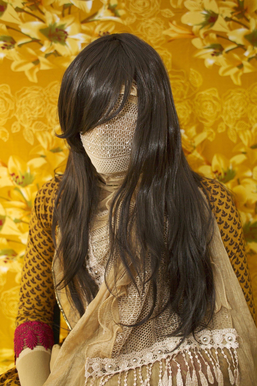 面部用金色布條遮住的孟加拉國女性