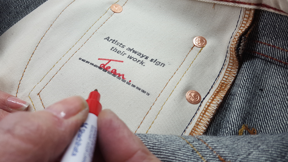 Hiut jeans being signed by the person who made them