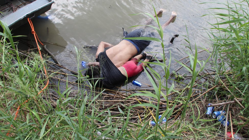 The lifeless bodies of a presumed migrant and his baby lie on a bank of the Rio Grande along the US-Mexico border