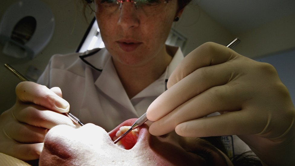 Dental patient being treated