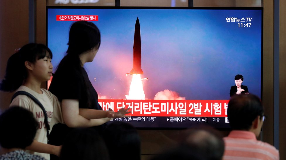 People watch a television showing a file picture of a North Korean missile for a news report on North Korea firing short-range ballistic missiles, in Seoul, South Korea, July 31, 2019.