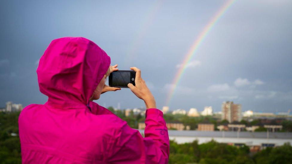 Mujer tomando foto