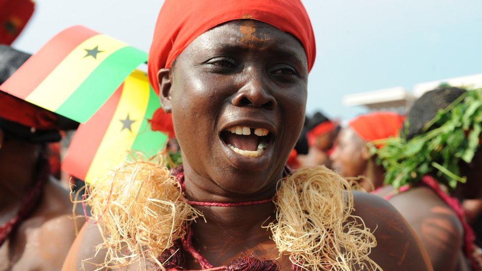A member of a cultural troupe dances during the funeral service of late Ghanaian president John Atta Mills at Independence Square in Accra on August 10, 2012