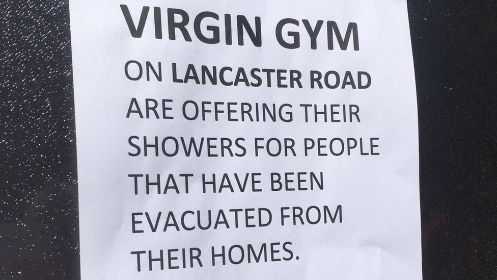 A sign offering local gym showers for those who have been evacuated from their homes