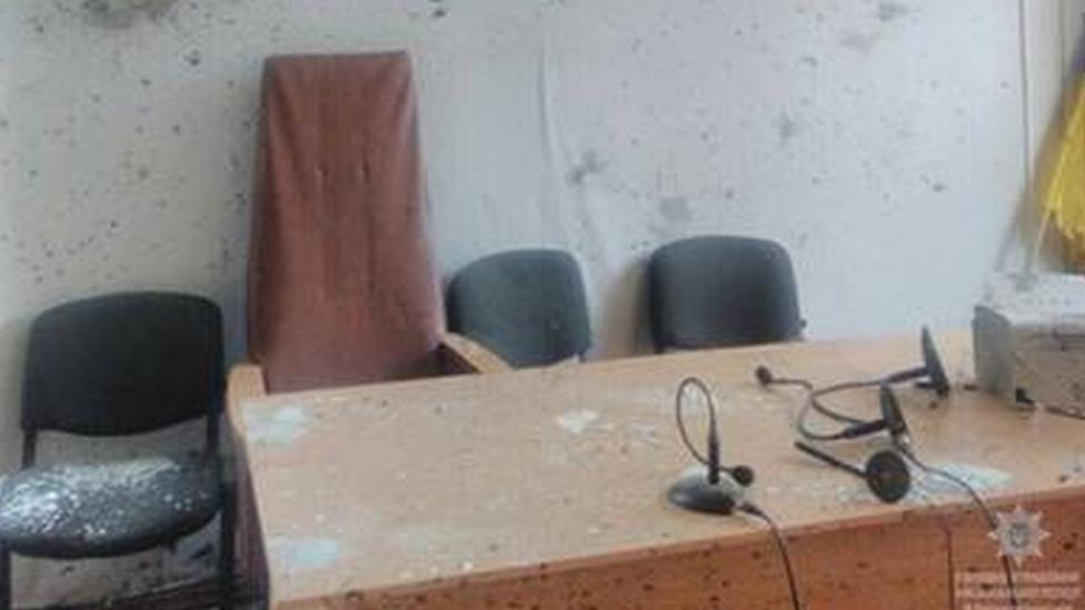Ukraine victim's father sets off courtroom grenades